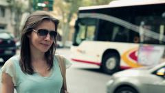 Attractive woman standing by the city street HD Stock Footage