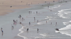 Tourists Playing at a Cornish Beach Wide Shot Stock Footage