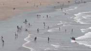 Stock Video Footage of Tourists Playing at a Cornish Beach Wide Shot