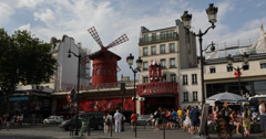 Ultra HD 4K Famous Iconic Moulin Rouge Show Paris Car Traffic People Passing Stock Footage