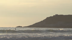 Surfers at Sunset in Cornwall Stock Footage