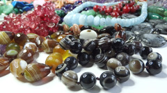 Semigem necklaces and beads jewelery as fashion background Stock Footage