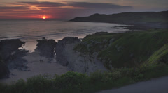 Sunset Landscape of Ocean / Cornish Headland Stock Footage