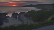 Stock Video Footage of Sunset Landscape of Ocean / Cornish Headland