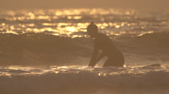 Female Surfer at Sunset Stock Footage
