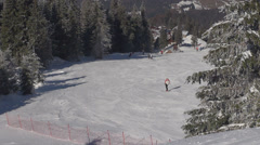Skier downhill snow piste mountain sport winter wintersport lifestyle enjoy day  Stock Footage