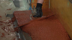 Red Cement being Smoothed with Trowel - stock footage