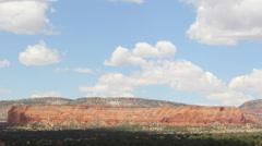 Stock Video Footage of Desert Cliffs Tilt Up to Clouds