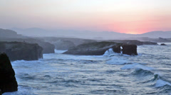 Beautiful sunset  on Playa de las Catedrales during inflow, Spain Stock Footage