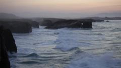 Storming waves during inflow at sunset on Playa de las Catedrales, Spain Stock Footage