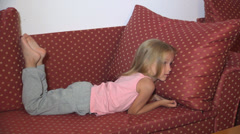 Child Watching TV, Sleepy Little Girl Lying on Bed, Coach, Close Up, Children Stock Footage