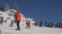 People prepare start ski skiing skier mountain alps peak snow blue sky sunny day Stock Footage
