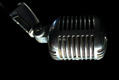 Elvis microphone vert on black - stock photo