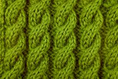 Closeup of green cable knitting stitch Stock Photos