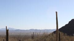 Desert Mountains Pan Left to Hills Stock Footage