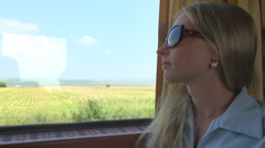Young woman girl sunglass serious meditative admire travel train fan hot day  Stock Footage