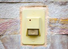 doorbell on wall - stock photo