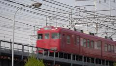 Red Meitetsu Train South of Nagoya Station - stock footage