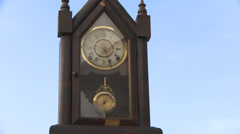 Clock pendulum on the sky time concept Stock Footage