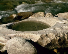 Conchoidal hollows in stone, created by glacial erosion Stock Footage