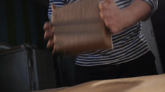 Forming a cube from the clay Stock Footage