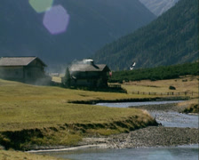 Krimmler Ache river runs gently through flat Alpine pastures - medium shot Stock Footage