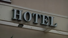 """HOTEL"" sign on white building. - stock footage"
