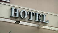 Stock Video Footage of Hotel sign on building.