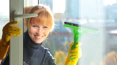 Women cleaning a window Stock Footage