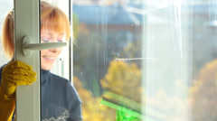 Women cleaning a window - stock footage
