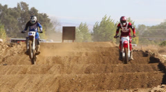 MOTOCROSS COOL POINT OF VIEW RIDER SUPERCROSS RACERS ON DIRTBIKE TRACK  HD Stock Footage