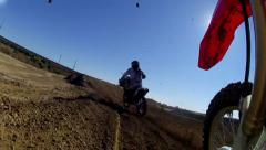 MOTOCROSS COOL POINT OF VIEW RIDER SUPERCROSS RACER ON DIRTBIKE TRACK HD Stock Footage