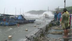 Fishermen Watch Storm Surge Waves Inundate Harbor Stock Footage