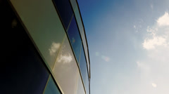 Office building curved windows and sky Stock Footage