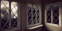 moody sky through windows - stock photo