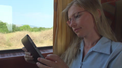 Woman young business glasses use tablet digital train travel computer girl day  Stock Footage