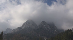 Storm clouds mountain peak alps forest dramatic winter season Stock Footage