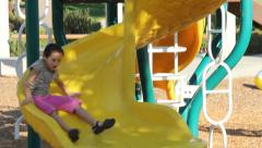 Girl Jungle Gym and Slide Stock Footage