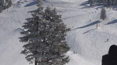 Skier downhill snow piste mountain sport winter wintersport enjoy sunny day  Stock Footage