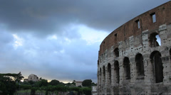 Colosseum and cloudy lit sky (ideal for titles) Stock Footage