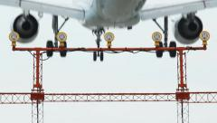 Lightbar detail with Jet coming in for landing. Rear view. Stock Footage