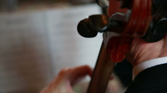 Cellist close up sheet music blurred Stock Footage