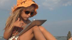 Girl, Child Thumbs Up Ok Playing on Tablet, Computer, Ipad Sea Beach, Children Stock Footage