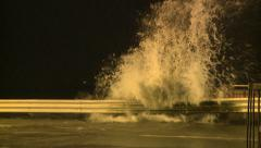 Big Waves Splash Onto Road During Tropical Storm - stock footage