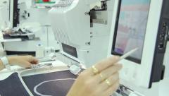 Female engineer working on computerized machine embroidery - stock footage