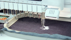 Machine embroidery working on jeans Stock Footage