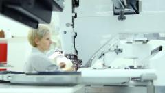 Woman working on computerized machine embroidery - stock footage