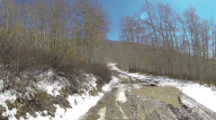 Muddy snow mountain trail 4x4 ride sun flare HD 0130 Stock Footage