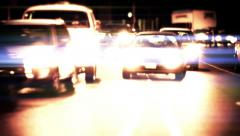 Traffic from front view, blurred headlights, light streaks - stock footage
