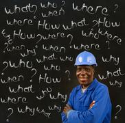 African american black man worker with chalk questions Stock Photos